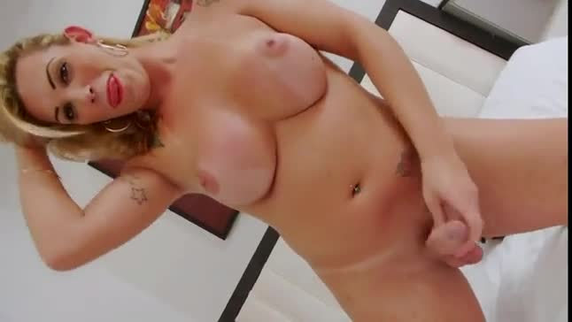 Busty blonde shemale jerks off before sucking
